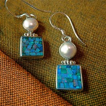 white cultured pearl above an opal mosaic  $38