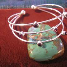 7 stone bracelet, available with garnet, amethyst, peridot $76
